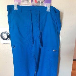 Grey's anatomy blue bottom scrubs.